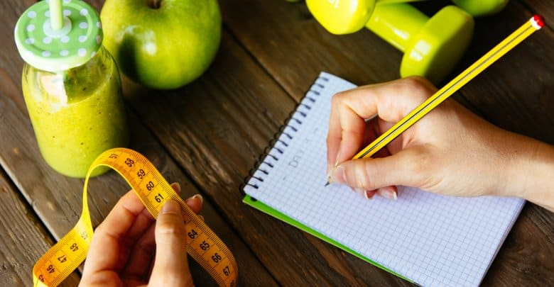 Fitness diet and nutrition routine concept with green detox smoo